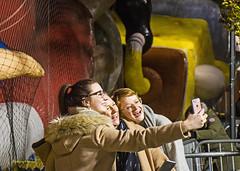 having fun (albyn.davis) Tags: people girls women balloons parade nyc newyorkcity usa yellow colors night light street emotion exuberance selfie manhattan macys thanksgiving