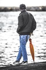 When it doesn't rain (De Mi Ser) Tags: candid streetphoto streetportrait man umbrella sea