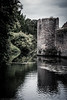 Moat (Anthony P26) Tags: architecture category england external places somerset travel wells architecturephotography travelphotography water moat castle stone tower stonewalling stonebuilding stonework sky greysky cloudy trees reflections reflection ripples canon canon70d canon1585mm outdoor fortification battlements turret