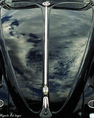 Little Black Bug (magnetic_red) Tags: sky black reflection vw clouds vintage bug emblem chrome retinaiiic ilobsterit