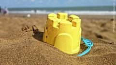 Face on sand besides the bucket at Sandown beach (dksesh) Tags: beach waves isleofwight atlanticocean sandown seshadri dhanakoti haritasya haritasa sonyxperiaz2