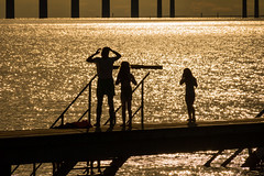 On a Dock (Infomastern) Tags: malm sibbarp bridge bro brygga dock hav mnniska people pier sea silhouette siluett water resundsbron exif:model=canoneos760d exif:aperture=14 geocountry camera:make=canon exif:isospeed=100 camera:model=canoneos760d geostate geolocation exif:lens=efs18200mmf3556is geocity exif:focallength=200mm exif:make=canon
