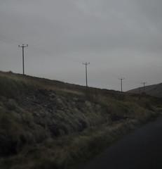 Roadside (Aaron Pennett) Tags: mourne mountains blacktop roadside telephone poles communications road tarmac wire follow moody greydays autumn atmosphere still silent quiet landscape