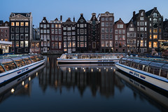 Amsterdam harbour (McQuaide Photography) Tags: amsterdam noordholland northholland netherlands nederland holland dutch europe sony a7rii ilce7rm2 alpha mirrorless 1635mm sonyzeiss zeiss variotessar fullframe mcquaidephotography adobe photoshop lightroom tripod manfrotto light licht dusk twilight bluehour longexposure stad city capitalcity urban lowlight architecture outdoor outside old oud gracht grachtenpand canalhouse house huis huizen traditional authentic water reflection centrum gebouw building waterfront waterside canal boat boot windows damrak travel traveldestination landmark famousplace tourism skyline wideangle wideanglelens groothoek rederijplas canalboat cruiseboat harbour calm tranquil