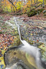 Rocky Whitewater Channel (Kenneth Keifer) Tags: colors creek fallcreek fallcreekgorge foliage indiana landscape leaves moss october stream thepotholes warrencounty waterfall autumn blurred brook canyon cascade cascading cataract chasm cliff color colorful erosion fall flow flowing forest gorge longexposure midwest nature plunge potholes preserve ravine rock rural sandstone scenic splash splashing stone swirls tiered tiers trees whitewater woods