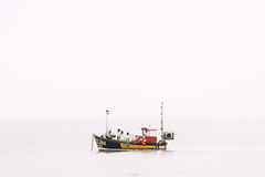 Leaden Skies [Explored] (ShrubMonkey (Julian Heritage)) Tags: leadenskies negativespace fishing boat selsey westsussex gray overcast flat coast coastal nautical sea water cloud leaden skies li188