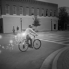 traveling light. (Photomaginarium) Tags: surreal canon powershot gimp light dream hope bringonthehope shineon letyourlightshine youhavealightinsideyou shareit bicycle streetphotography inspiration imagination therearenomistakes happyaccidents simplicity magic