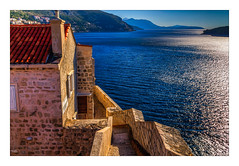 Looking Back (Kevin, from Manchester) Tags: architecture building canon1855mm clouds croatia dalmatiancoast dubrovnik hdr harbour historical kevinwalker oldcity oldtown photoborder sea water wall