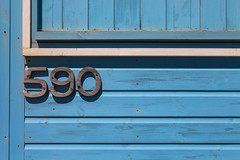 590 (justingreen19) Tags: 590 beachhuts england essex essexcoast frinton numbers waltononthenaze address beachhut beaches beachfront blue coast font huts justingreen19 lettering lightblue lines numbered numbering paint painted paintedwood seaside texture typeface wood woodenhut woodennumbers shed fade fading