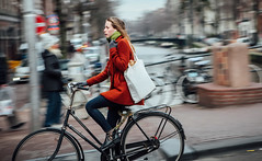 Pedal Mode (Rolling Spoke) Tags: bike bicycle bici bicicleta bicicletta bisiklet ciclismo fiets fahrrad velo street style chic cycle cycling girl red jacket tote bag pan panning motion amsterdam