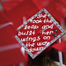 A mortarboard quotes the late newscaster and North Carolina native David Brinkley.