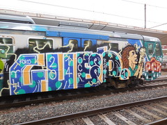 DSCN6478 (en-ri) Tags: train writing torino graffiti blu arrow koko nero gocce ocr tizio coppa pallini rotie indaco cued