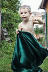 boy with green fabric (studioimagonis) Tags: boy playing green grass childhood tattoo standing happy moving movement holding child looking fulllength fabric browneyes littleboy bluehair oneperson childrenonly