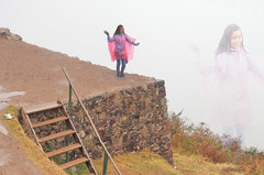 Peru (bilwander) Tags: peru pisac teen girl pink raincoat playing rain inkas wall gate fog cusco solo travel bilwander ρeru