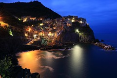 ~ Dusk @Manarola,  the Cinque Terre () ~ (PS~~) Tags: ocean santa blue summer vacation sky italy sun holiday seascape streets color church water colors rock stone landscape coast harbor boat town fishing colorful aqua mediterranean sailing ship turquoise liguria terraces shoreline azure touris