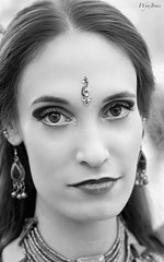 Exotic Kimberly (wyojones) Tags: blackandwhite bw woman usa white black cute girl beautiful beauty look festival lady nose necklace eyes pretty texas expression makeup bellydancer dancer lips trf faire earrings kimberly renfaire grayscale brunette lovely renaissancefestival collar browneyes fest renaissance renaissancefaire renfest maiden jewel wench greyscale rennie texasrenaissancefestival toddmission wyojones