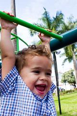 Hold on!!! (Beto Vilaboim) Tags: boy colors smile playground child sunnyday