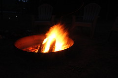 Campfire. (|SNAPShots| by: Patrick J.Whitfield) Tags: camera longexposure camping light red wild summer camp orange ontario canada hot macro slr nature yellow night forest canon outside outdoors fire photo