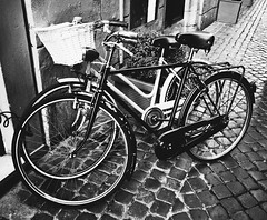 Two classic vintage retro city bicycles, bw photo, Rome, Italy (k_maxim) Tags: bike retro wall rome street town pedal white spring travel ride european urban life culture sunny seat old black traditional building copenhagen wheel historic cycle transport reflection architecture city bw italy classic transportation antique vintage style background grunge water bicycle weathered rusted rusty europe metal capital