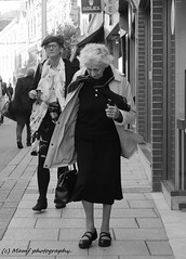 Juxtaposition. ((c) MAMF photography..) Tags: blackandwhite blackwhite britain bw biancoenero blancoynegro blanco blancoenero city candid england enblancoynegro flickrcom flickr google googleimages gb greatbritain greatphotographers greatphoto inbiancoenero image leeds ls1 leedscitycentre mamfphotography mamf monochrome nikon noiretblanc noir negro north nikond7100 northernengland photography pretoebranco photo people schwarzundweis schwarz town uk unitedkingdom upnorth woman westyorkshire yorkshire zwartenwit zwartwit zwart street