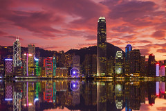 Day and Night (UrbanCyclops) Tags: hongkong china asia skyline cityscape skyscrapers towers buildings night lights sunset sky clouds metropolis central island architecture colourful red reflections harbour water density urban city