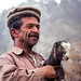 A man with a little goat, Karimabad, Pakistan パキスタン、カリマバード 子ヤギを抱いた男性