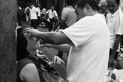 Street Dentist - Kuala Lumpur (Chot Touch) Tags: kualalumpur chinatown pasarkarat petalingstreet malaysia doctor dentist blackwhite streetphotography emotion tradisional pain