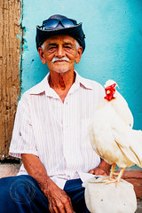 Untitled (Simone Della Fornace) Tags: people travel cuba cuban trinidad person oneperson chicken hat old wrinkles sony a7rii portrait face