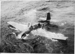 A wet few minutes before rescue for the crew of a Fleet Air Arm Grumman Avenger after it had landed in the sea when its engine failed on leaving the carrier HMS SMITER during the operations against Sakishima in support of the American landing on Okinawa, 2nd April 1945.