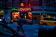 NYC Liquors (A7design1) Tags: street city nyc usa color building sign yellow modern night dark lights store neon shoot shot display dusk walk cab flash front alcohol oneway liquors businessmen