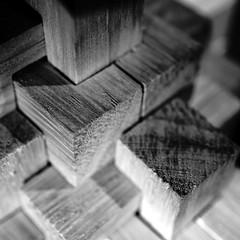 Cubic (Ben Wightman) Tags: wood blackandwhite macro square puzzle squareformat blocks cubes woodgrain macromonday