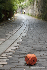 A Roll Of The Dice (DMeadows) Tags: road street people orange dice men stone wall walking scotland die shot path walk glasgow curves cider cobbled cobble numbers drinks roll curved cobbles walkers davidmeadows dmeadows
