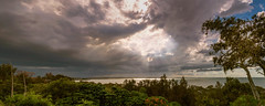 Storm - Wellington Point (JoPerkins Photography) Tags: trees light storm water clouds grey rays