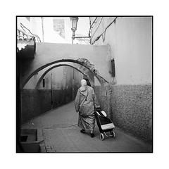 back from the souk • essaouira, morocco • 2014 (lem's) Tags: street woman rolleiflex arch femme arcade morocco maroc souk cart rue essaouira planar caddie