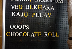 Ooops Chocolate Roll (cowyeow) Tags: city food india strange sign dessert restaurant funny chocolate indian humor bad badsign vegetarian oops maharashtra bukhara misspelled bizarre pune funnysign indianfood misspell chocolateroll blacksign funnyindia kajupulav