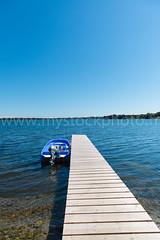 Boat and Pontoon (nportais) Tags: wood travel bridge blue sunset summer sky white lake beach nature water island boat fishing waves background leisure activity relaxation pontoon