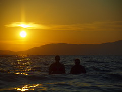 swimming by sunset _9020512 (hans 1960) Tags: sun sunset sonnenuntergang sol soleil meer wasser water swimming hills berge two golden licht light spiegelung refexion mittelmeer strand beach nature natur spanien malle mallorca urlaub holiday dreams trume girls himmel sky outdoor
