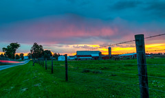 Sunsationally Scenic (tquist24) Tags: hdr indiana nikon nikond5300 barbedwire barn blue clouds farm farmhouse fence geotagged grass horse horses lightstream lighttrails longexposure morning orange pasture road rural silo sky sunrise tree trees middlebury unitedstates wow