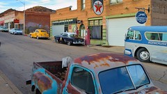 Quiet overcast morning - Erie Street, Lowell district, Bisbee, Arizona (edk7) Tags: nikond3200 edk7 2013 us usa arizona cochisecounty bisbee lowell ghosttownheritagedistrict old vintage classic architecture building oldstructure city cityscape urban car bus pickup rust signage texaco greyhound indian gasstation gaspump taxi policecar cadillac road crack eriestreet coppermineslagheap