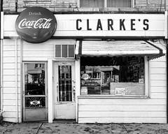Clarke's (Sally E J Hunter) Tags: toronto coke cocacola sign store front blackwhite blackandwhite clarkes dawes road eastyork storefront cornerstore