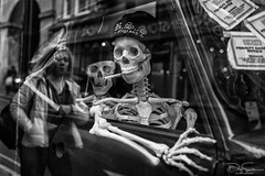smoking kills (Daz Smith) Tags: dazsmith fujixt10 fuji xt10 andwhite bath city streetphotography people candid canon portrait citylife thecity urban streets uk monochrome blancoynegro blackandwhite mono smoking cigarette refelction windo skeleton skulls
