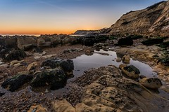 On the rocks (James Waghorn) Tags: sigma1020f456 seaweed beach contrails pettlevel sunset water reflections pebbles rocks winter eastsussex d7100 sea alone solitude peace england