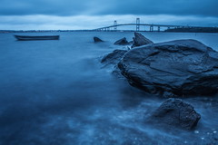 Rhode Island (Elliotphotos) Tags: ocean new longexposure bridge blue england water rock boats island evening boat rocks dusk bluewater bridges newengland boulder atlantic boulders rhodeisland newport oceans elliot rhode atlanticocean jamestown evenings pell longexposures claiborne newportbridge 297 jamestownbridge claibornepellnewportbridge claibornepell gilfix claibornepellbridge elliotgilfix