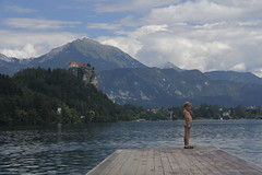 A Small Mountain (FineTemps) Tags: lake mountains colour water child view slovenia bled coulds lakebled