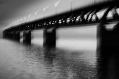 Corner (c e d e r) Tags: bridge bw yellow train copenhagen denmark sweden bro malm icm oresund vitt svart resund resundsbron oeresund intentionalcameramovement l1014815