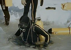 Vintage ice diving in black wetsuit with yellow striping. (Vintage Scuba) Tags: two 3 man black men ice window wet water yellow fetish vintage silver one us belt divers aqua snorkel mask under scuba diving rubber suit mans mens diver piece jacques weight striped drysuit fins wetsuit bcd breathing lung aparatus neoprene fenzy