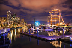 Purple Pier (TIA International Photography) Tags: seattle summer reflection wheel skyline night clouds sailboat port training buildings tia lights evening harbor pier boat washington dock downtown mood sailing ship skyscrapers cloudy harbour song stadium platform illumination atmosphere prince vessel landmark ferris mexican walkway single promenade be pacificnorthwest sail seahawks summertime elliottbay motorboat attraction alaskanway waterfont pier66 newgirl zooeydeschanel greatwheel cuauhtmoc tosinarasi tiascapes tiainternationalphotography centurylink fallinlove2nite