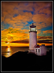 Unforgetable (http://fineartamerica.com/profiles/robert-bales.ht) Tags: ocean statepark blue sunset red lighthouse seascape reflection building tower beach yellow clouds buildings spectacular washington twilight marine awesome fineart masonry shoreline scenic peaceful pacificocean sensational inspirational sunrisesunset magnificent haybales fresnellens capedisappointment caped northheadlighthouse llighthouse beautifultones canonshooter lighthousephotography longbeacharea aidtonavigation marinephotography washingtonstatephotography americanphotograph robertbales costalphotography northamericanphotography