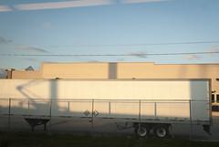 Wall Shadows (alankin) Tags: light philadelphia geometric lines buildings shadows pennsylvania fences chainlink pa powerlines wires fromthetrain inpassing walls septa urbanlandscape lookingout trainline r5 windowreflections niknala nikkoraf24mmf28 nikond300 brynmawrlocal 5oct2009 pantographshadows 1800180au