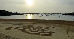 coucher de soleil sur le sable.
